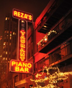 Exterior and glowing sign of Reza's