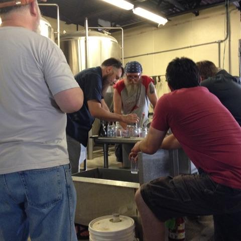 Brewers huddle together on brew day.