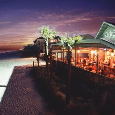 Schooners beach club at night.