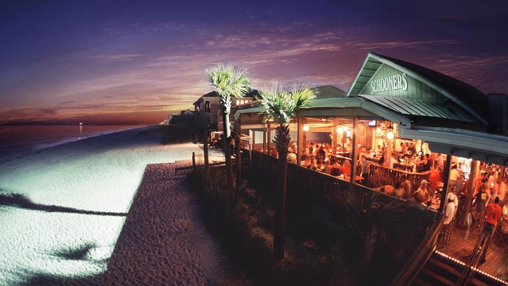 Schooners beach club at night.
