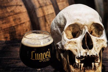 A skull on a barrel next to Phantom Carriage Brewery's Lugosi beer