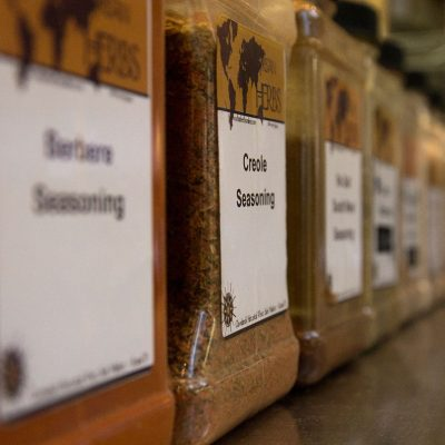 Spices line a case at West Side Market - PHOTO // Wolf and Blue Studios
