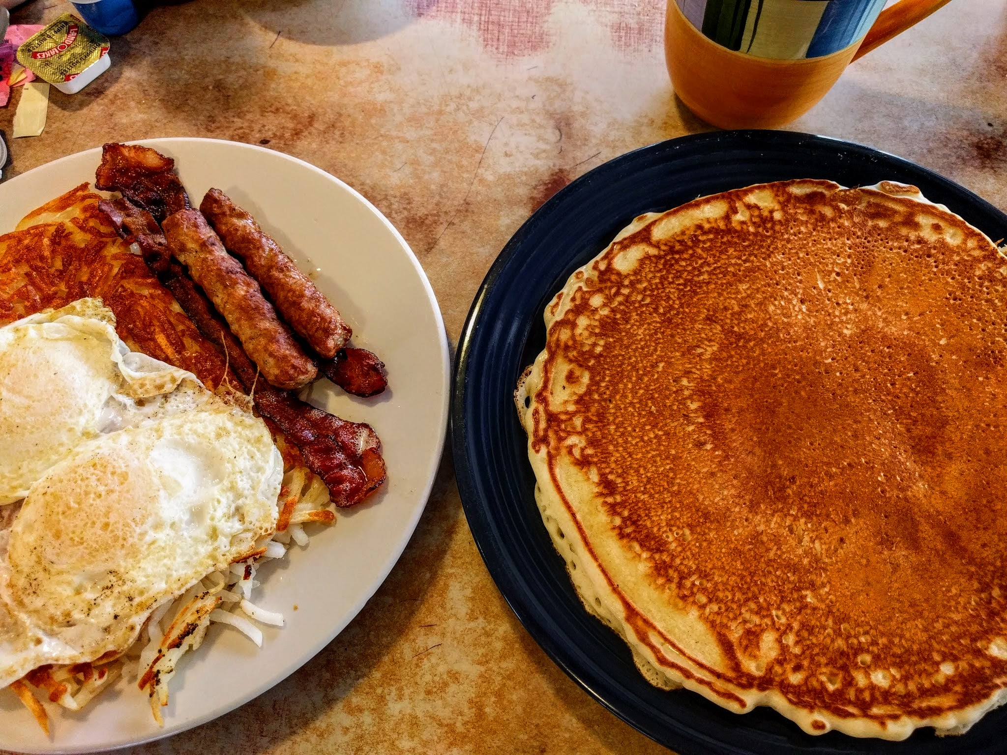 A breakfast spread of pancakes, eggs and sausage at Jim-Denny' in Sacramento
