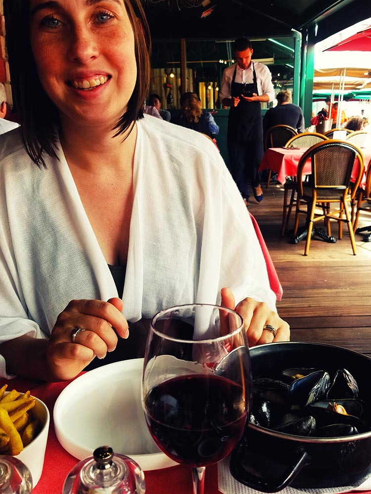 A large bowl of mussels sits in front of Scott Davis' wife Erin.