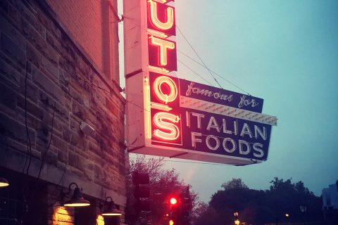 An exterior shot of Saputo's Italian Restaurant at night.