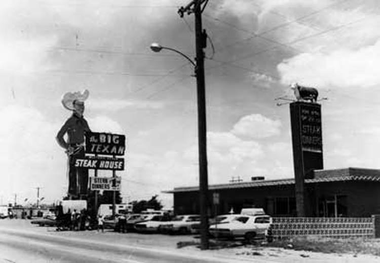 A historical look back at Amarillo's The Big Texan Restaurant with old cars and the big sign.
