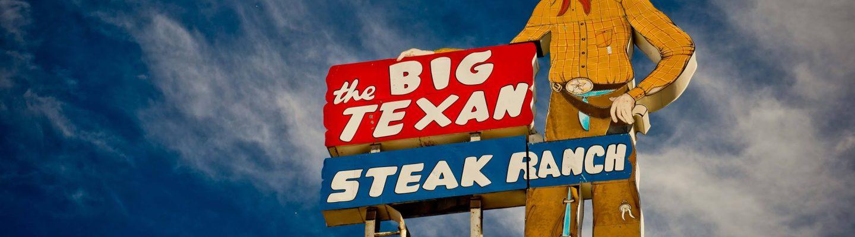 The Big Texan sign against a sky.