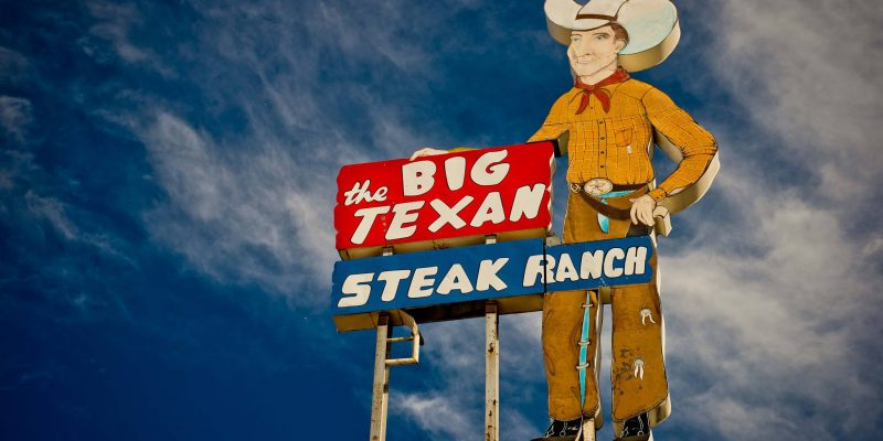 The Big Texan sign against a sky.