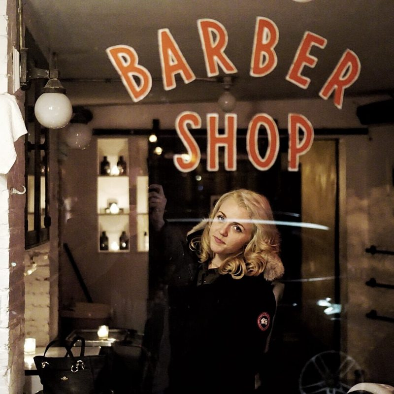 The author inside the dimly lit barber shop.