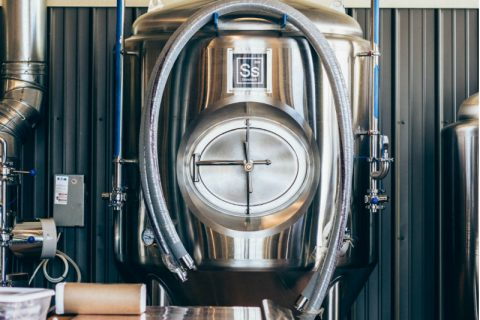 A stainless steel homebrew kettle.