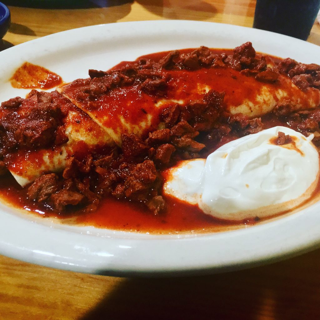A burrito covered in tomato sauce from Los Rancheros.