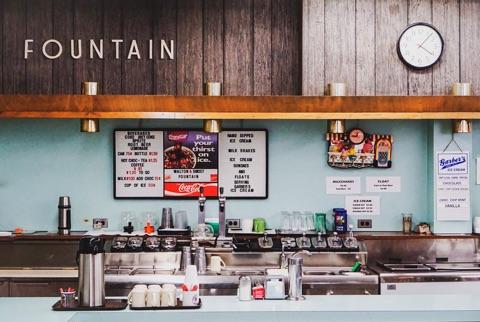 The counter and menuboard at an old soda shop.